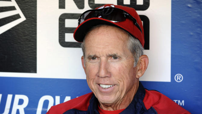 FILE - In this July 24, 2012, file photo, Washington Nationals Manager Davey Johnson sits in the dugout during batting practice before a baseball game against the New York Mets at Citi Field in New York.  Johnson was voted as the National League Manager of the Year on Tuesday, Nov. 13, 2012. (AP Photo/Kathy Kmonicek, File))