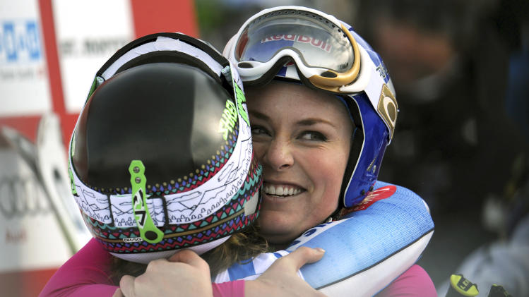 Lindsey Vonn, right, of the United States, hugs her teammate Laurenne Ross as she celebrates after winning an alpine ski, women's World Cup super-G, in St. Moritz, Switzerland, Saturday, Dec .8, 2012. (AP Photo/Giovanni Auletta)