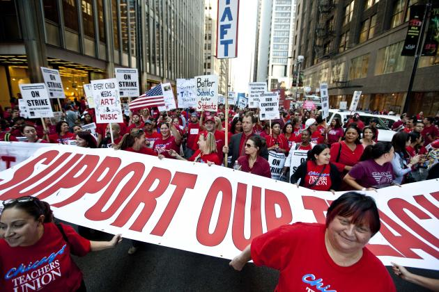Thousands of public school teachers rally outside Chicago Public Schools district headquarters on the first day of strike action over teachers' contracts on Monday, Sept. 10, 2012 in Chicago. For the