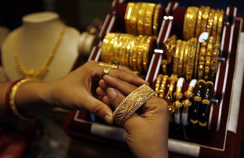 Woman wears gold bangle at jewellery shop in Siliguri