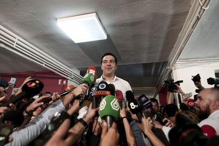 Tsipras addresses media after voting at a polling station in Athens