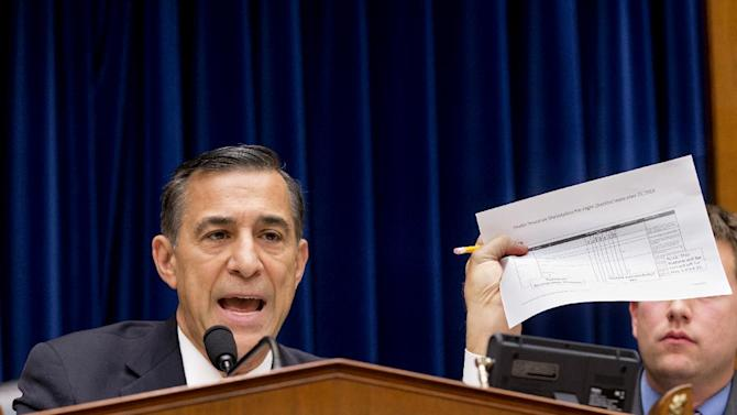 """FILE - In this Nov. 13, 2013 file photo, House Oversight Committee Chairman Rep. Darrell Issa, R-Calif., holds up a checklist related to the preparation for the implementation of the Obamacare healthcare program, and specifically, the HealthCare.gov website, on Capitol Hill in Washington. For two months, the talk was all about computer code. About response times. About glitches and bugs. Issa, who misses no opportunity to investigate perceived shortcomings in the health care program, devoted a full hearing to the """"limitations of Big Government"""" when it comes to health care. (AP Photo/J. Scott Applewhite, File)"""