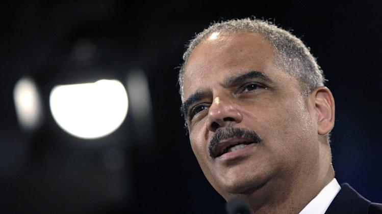 File photo of U.S. Attorney General Holder speaking at the Justice Department in Washington