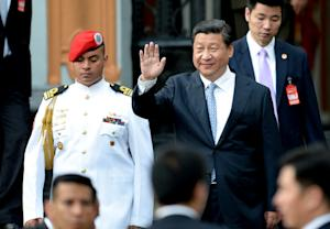 Xi Jinping waves while leaving the National Pantheon, …