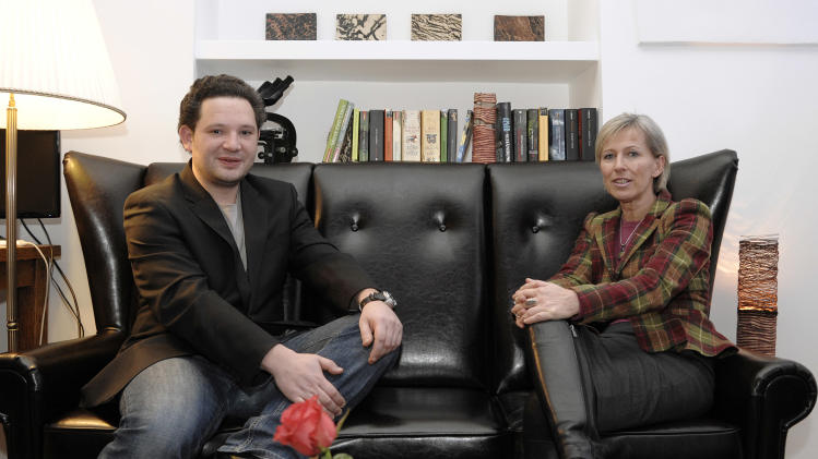 In this picture taken Tuesday, Feb. 5, 2013 owners Peter Schurin, left, and Claudia Darnhofer of Reflexia Studio in Vienna, Austria, pose in their studio. One sleepy little side street in Vienna just got sleepier. Tucked away behind a Gothic church and surrounded by Renaissance-era houses, the new studio is offering deal-makers, movers and shakers and foot-sore tourists respite at a price — a half-hour power nap for 11 euros (US dollar 15). (AP Photo/Hans Punz)