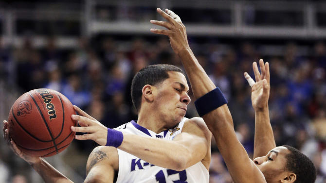 Kansas State guard Angel Rodriguez (13) is covered by La Salle guard Tyreek Duren (3) during the first half of a second-round game in the NCAA college basketball tournament at the Sprint Center in Kansas City, Mo., Friday, March 22, 2013. (AP Photo/Orlin Wagner)