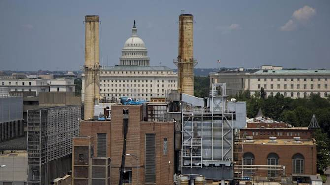 The Capitol Dome is seen behind the Capitol Power Plant in Washington, Monday, June 24, 2013. The plant provides power to buildings in the Capitol Complex. President Barack Obama is running out of time to make good on his lofty vow to confront climate change head-on, and Congress is in no mood to help. The executive actions and regulations Obama announces Tuesday will take years to implement. (AP Photo/Carolyn Kaster)