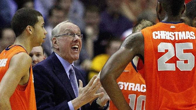 Syracuse head coach Jim Boeheim talks to his players during a timeout in the first half of the East Regional final in the NCAA men's college basketball tournament against Marquette, Saturday, March 30, 2013, in Washington. (AP Photo/Mark Tenally)