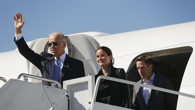 Vice President Joe Biden, left, followed by his daughter Ashley Biden, center, and son Beau Biden, right, walk out of Air Force Two upon their arrival at Lexington Blue Grass Airport, Thursday, Oct. 11, 2012, in Lexington, Ky., for the vice presidential debate. (AP Photo/Pablo Martinez Monsivais)