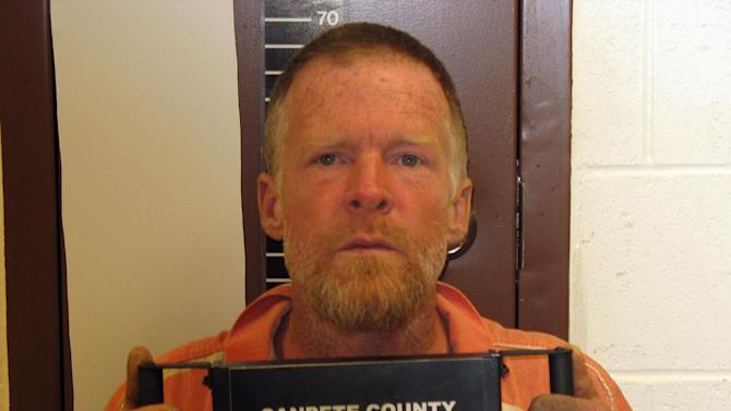 "FILE - This photo released by the Sanpete County Sheriff's Office shows Troy James Knapp.  On April 2, 2013, authorities captured Knapp, an elusive survivalist who is suspected of burglarizing Utah cabins and leaving some covered with threats and bullet holes, ending a saga that began six years ago and drew in police and residents around the state. Knapp, dubbed the ""Mountain Man"" by cabin owners, was taken into custody in the snowy mountains outside of Ferron in central Utah after firing several shots at officers in a helicopter, authorities said.(AP Photo/Sanpete County Sheriff's Office )"