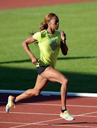 US athlete Sanya Richards-Ross, a 400 metres runner, practices during a training session at Alexander Stadium, the US Olympic athletics team training camp, in Birmingham on July 23, 2012 four days before the official start of the London 2012 Olympic Games. AFP PHOTO / ADRIAN DENNIS