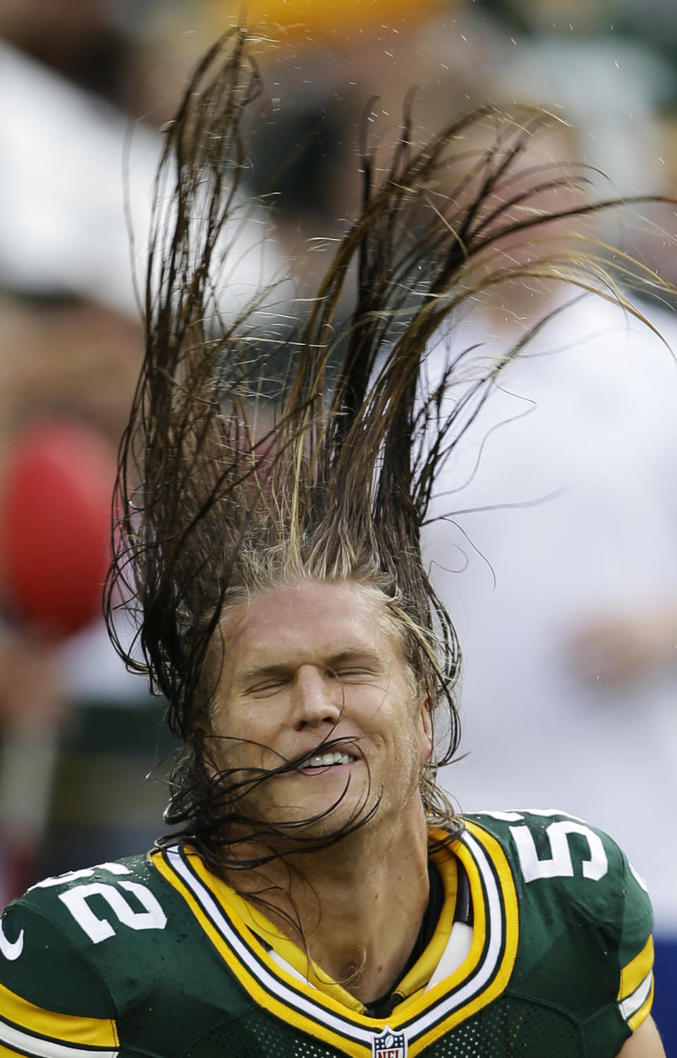 Green Bay Packers linebacker Clay Matthews flips his hair before a preseason NFL football game against the Cleveland Browns Thursday, Aug. 16, 2012, in Green Bay, Wis. (AP Photo/Jeffrey Phelps)