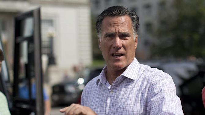 "Republican presidential candidate, former Massachusetts Gov. Mitt Romney speaks with the news media after making a stop at the ""New Hampshire Veterans and Military Families for Mitt"" event in Concord, N.H., Thursday, Sept. 6, 2012.  (AP Photo/Evan Vucci)"