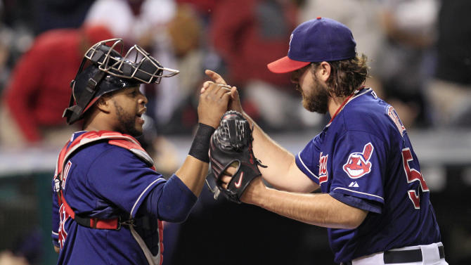 Cleveland Indians' Carlos Santana, left, congratulates pitcher Chris Perez after the Indians beat the Detroit Tigers 5-3 in a baseball game, Tuesday, May 22, 2012, in Cleveland. (AP Photo/Tony Dejak)
