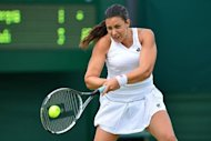 France's Marion Bartoli plays a shot during her first round women's singles victory over Australia's Casey Dellacqua on the second day of the 2012 Wimbledon Championships tennis tournament at the All England Tennis Club in Wimbledon, southwest London, on June 26