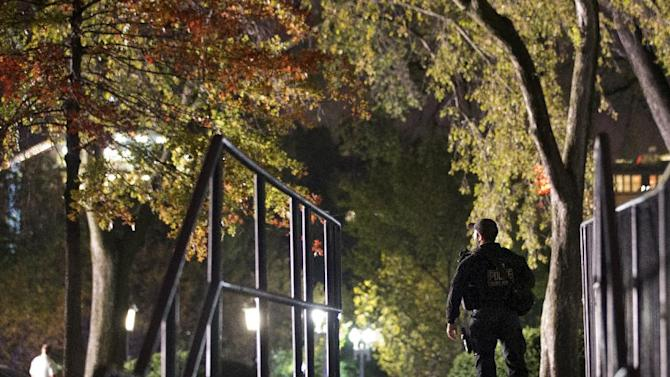 Secret Service respond on the North Lawn of the White House after a man jumped the White House fence, Wednesday, Oct. 22, 2014, in Washington. The Secret Service apprehended the man who jumped over the White House fence. This latest incident comes about a month after a previous White House fence jumper sprinted across the lawn, past armed uniformed agents and entered the mansion. (AP Photo/Jacquelyn Martin)