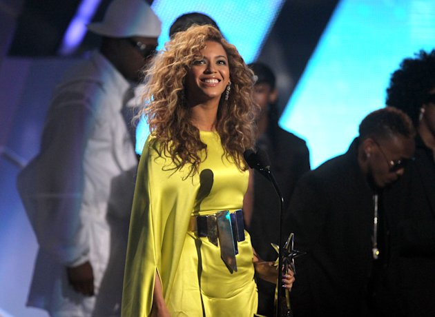 Beyonce accepts the award for best female R& B at the BET Awards on Sunday, July 1, 2012, in Los Angeles. (Photo by Matt Sayles/Invision/AP)