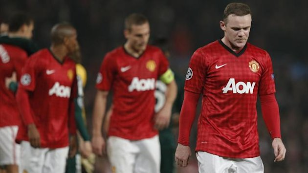 Manchester United's Wayne Rooney reacts after the Champions League soccer match against Real Madrid at Old Trafford stadium in Manchester, March 5, 2013 (Reuters)