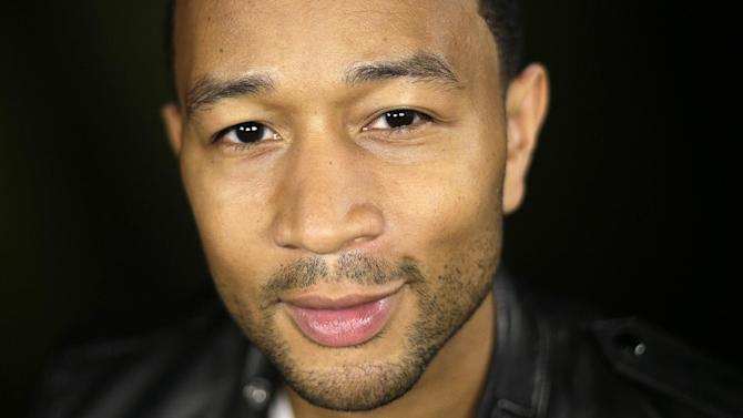 """In this Thursday, Aug. 29, 2013 photo, singer John Legend poses for photos after an interview, in Los Angeles. Legend's fourth album, """"Love In The Future,"""" went on sale on Sept. 3, 2013.. (AP Photo/Jae C. Hong)"""