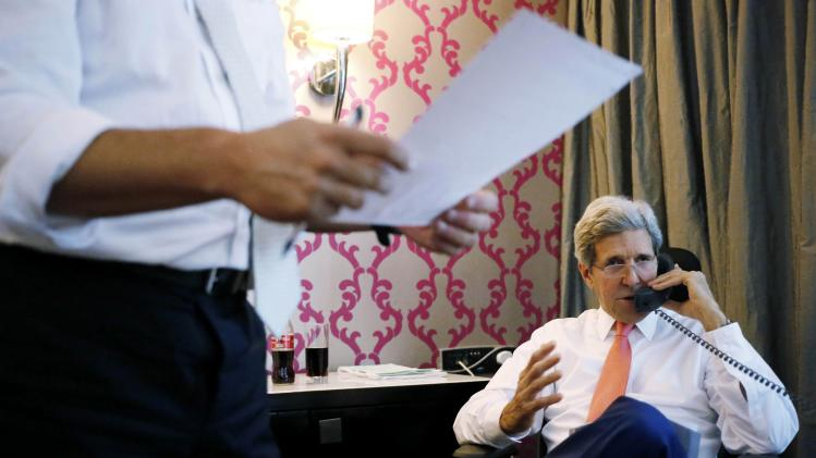 U.S. Secretary of State Kerry speaks on the phone to Israeli PM Netanyahu from his hotel suite in Cairo
