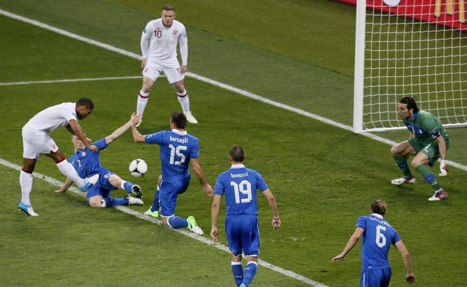 England's Glen Johnson, left, shoots during the Euro 2012 soccer championship quarterfinal match between England and Italy in Kiev, Ukraine, Sunday, June 24, 2012. (AP Photo/Vadim Ghirda)