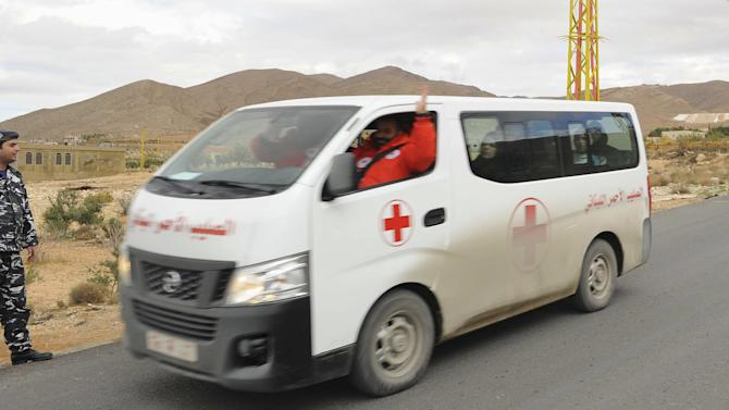 A Red Cross vehicle, part of a convoy, carrying the newly released Lebanese soldiers and policemen who were captured by the al Qaeda-linked Nusra Front in Arsal, is seen leaving the border town of Arsal, in eastern Bekaa Valley
