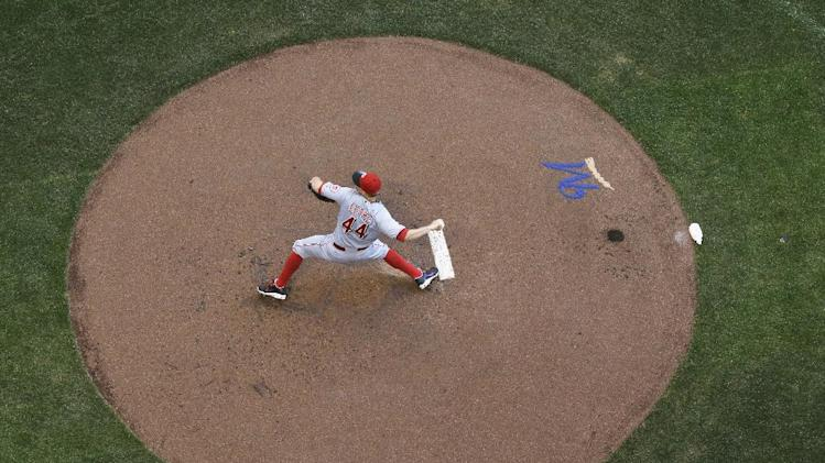 Cincinnati Reds starting pitcher Mike Leake throws during the first inning of a baseball game against the Milwaukee Brewers Wednesday, July 23, 2014, in Milwaukee. (AP Photo/Morry Gash)