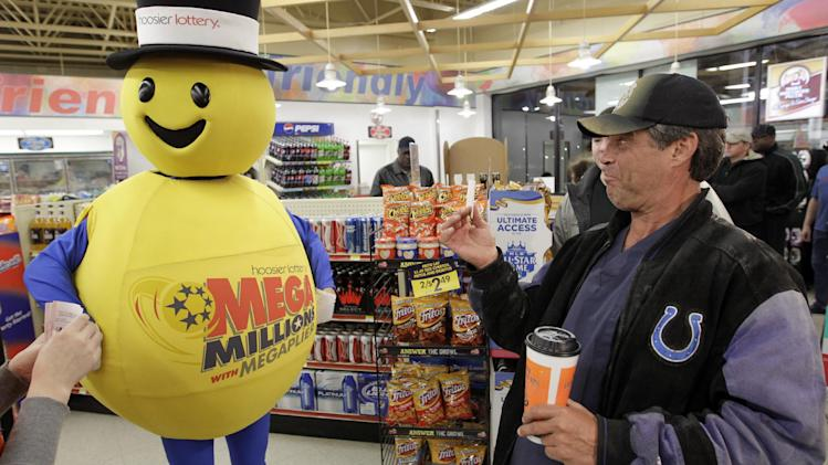 A customer smiles after receiving a free Mega Millions Lottery ticket from the Hoosier Lottery's Mega Millions mascot at a store in Zionsville, Ind., Friday, March 30, 2012. The Mega Millions Lottery jackpot has reached a record $540 million.(AP Photo/Michael Conroy)