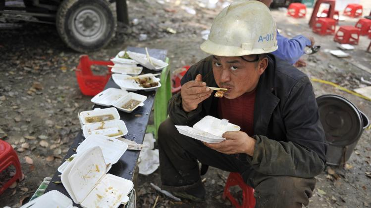 A migrant worker eats during his lunch break in Hefei, Anhui province