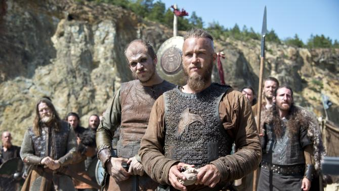 In this photo dated July, 8 2013 Ragnar, front, played by actor Travis Fimmel, a leading character from television show Vikings, History's brooding and brutal drama about the 8th-century Nordic warrior Ragnar Lothbrok. After a six-month shoot in Ireland, season two debuts Thursday night sporting a bigger scale, more confident pace and stronger entertainment than last year's uneven, at-times plodding inaugural run.(AP Photo/Bernard Walsh/History)