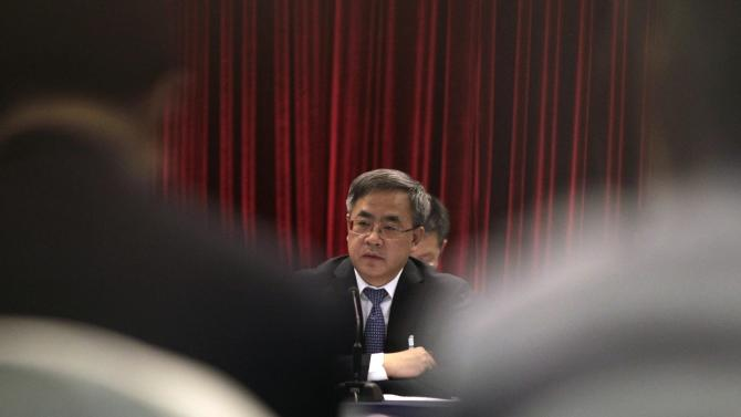 Guangdong Communist Party Secretary Hu gestures as he answers a question during the Guangdong delegation's group discussion during the National People's Congress, in Beijing