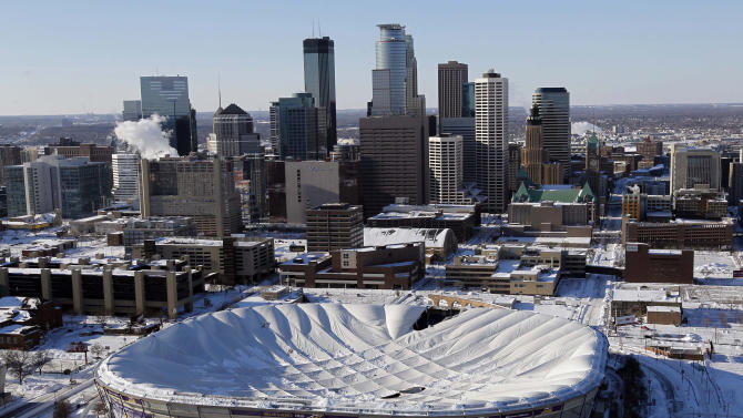 The collapsed roof of the Metrodome is shown in this aerial view  in Minneapolis on Sunday, Dec. 12, 2010. The inflatable roof of the Metrodome collapsed Sunday after a snowstorm that dumped 17 inches on Minneapolis. No one was hurt, but the roof failure sent the NFL scrambling to find a new venue for the Vikings' game against the New York Giants. (AP Photo/Ann Heisenfelt)