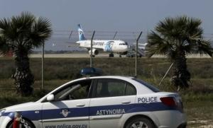 Police stand guard at Larnaca Airport near a hijacked …