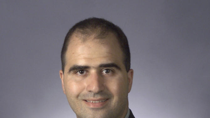 FILE - This 2003 picture provided by the Uniformed Services University of the Health Sciences shows Nidal Malik Hasan in his graduation photo when he completed his M.D. degree. Born in Arlington, Va. to Palestinian parents, Hasan joined the U.S. Army in college and became a military psychiatrist. Colleagues said that during an assignment at Walter Reed Medical Center, he was deeply affected by dealing with young soldiers wounded in Iraq and Afghanistan. Hasan was wounded and captured by police on Nov. 5, 2009, after he allegedly opened fire on soldiers in Fort Hood, Texas, killing 13 and wounding 29.(AP Photo/Uniformed Services University of the Health Sciences)