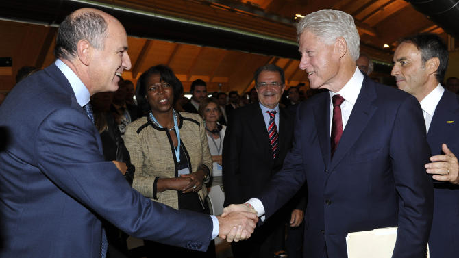Former US President Bill Clinton, right, shakes hands with the Italian Minister of Economic Development, Infrastructure and Transport Corrado Passera during the inauguration of the Italian fitness equipment manufacturer Technogym Village and the 20th Wellness Congress, in Cesena, Italy, Saturday, Sept. 29, 2012. (AP Photo/Gian Mattia D'Alberto, Lapresse) ITALY OUT