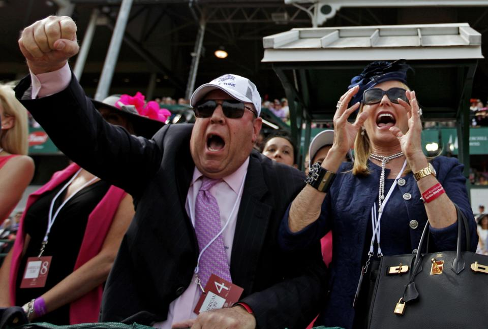 Owner Martin Schwartz and his wife Audrey celebrate as their horse Noble Tune wins the10th race before the running of the 139th Kentucky Oaks at Churchill Downs Friday, May 3, 2013, in Louisville, Ky. (AP Photo/David Goldman)