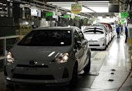 Toyota cars roll off the Japanese production line