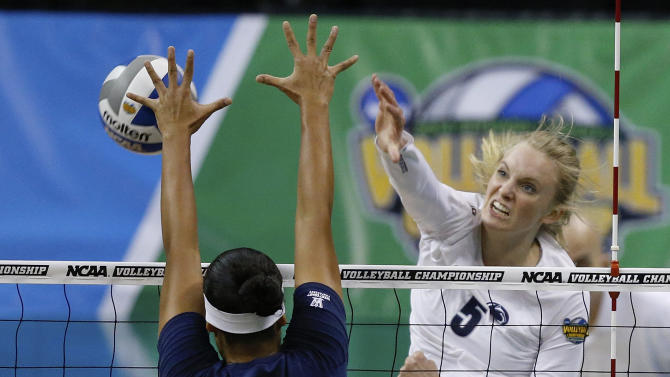Penn State's Ali Frantti (5) hits against Penn State's Kendall Pierce (3) during the NCAA women's volleyball tournament championship match in Oklahoma City, Saturday, Dec. 20, 2014. (AP Photo/Sue Ogrocki)