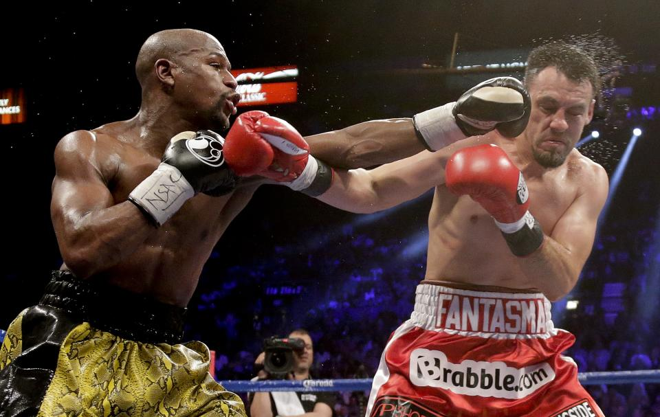 Floyd Mayweather Jr. lands a left jab against Robert Guerrero in the fifth round during a WBC welterweight title fight, Saturday, May 4, 2013, in Las Vegas. (AP Photo/Rick Bowmer)