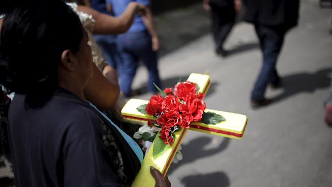 Relatives participate in the burial of  a victim of a mudslide in Santa Catarina Pinula, on the outskirts of Guatemala City