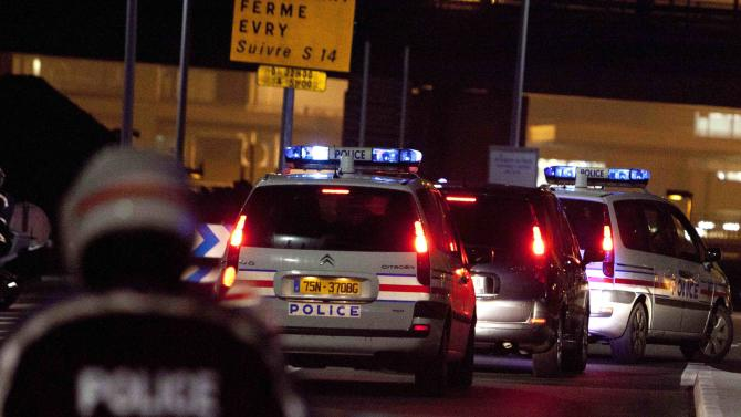 A police car, second from right, believed to be carrying former Panamanian military strongman Manuel Noriega arrives at Orly airport, south of Paris, after leaving La Sante Prison Sunday, Dec. 11, 2011. Noriega left France Sunday for further punishment in his homeland after more than 20 years in U.S. and French jails for drug trafficking and money laundering. (AP Photo/Thibault Camus)