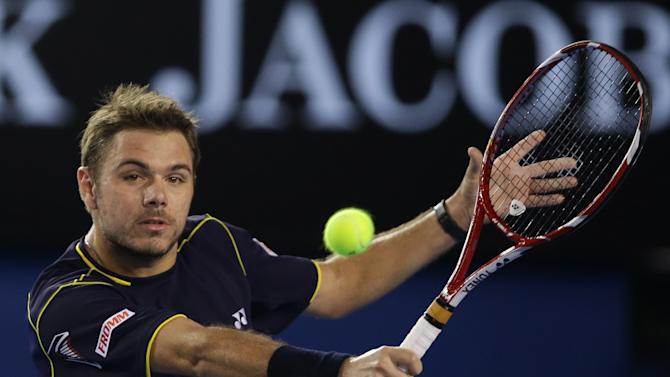 Switzerland's Stanislas Wawrinka plays a backhand return to Serbia's Novak Djokovic  during their fourth round match at the Australian Open tennis championship in Melbourne, Australia, Sunday, Jan. 20, 2013. (AP Photo/Dita Alangkara)