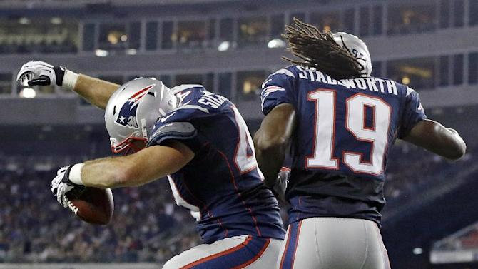 New England Patriots tight end Alex Silvestro, left, celebrates his second quarter touchdown with teammate Donte Stallworth (19) against the Philadelphia Eagles during an NFL preseason football game in Foxborough, Mass., Monday, Aug. 20, 2012.(AP Photo/Elise Amendola)