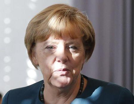 Merkel rebuffs party pressure to take tougher line on refugees