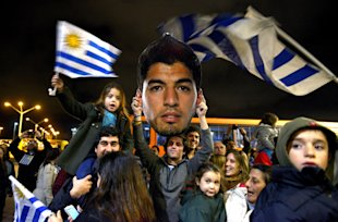 Uruguayans have been unwavering in their support of Suarez after his third biting incident. (AP)
