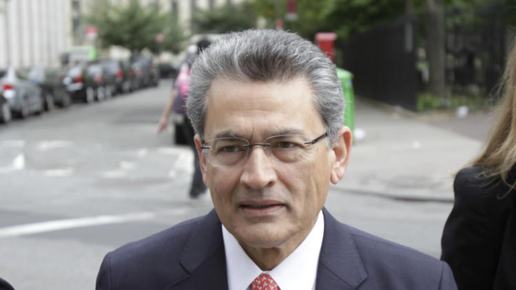 Rajat Gupta arrives at court in New York, Tuesday, June 12, 2012.  Gupta is pleading not guilty to charges he passed secrets he learned from Goldman's board in fall 2008 to a billionaire hedge fund founder who used the information to make millions of dollars. (AP Photo/Seth Wenig)