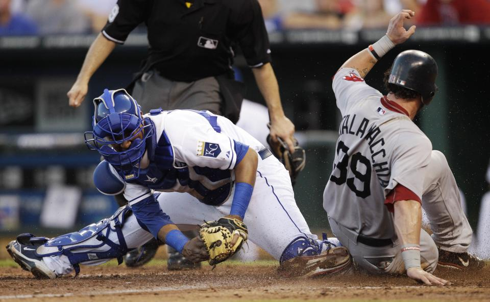 Kansas City Royals catcher Salvador Perez is late tagging Boston Red Sox's Jarrod Saltalamacchia (39) during the sixth inning of a baseball game in Kansas City, Mo., Saturday, Aug. 20, 2011. Saltalamacchia scored on a single by teammate Ryan Lavarnway. (AP Photo/Orlin Wagner)