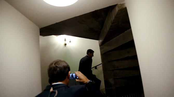 U.S. Representative Ryan is trailed by a reporter as he returns to his office after a Republican caucus meeting at the U.S. Capitol in Washington