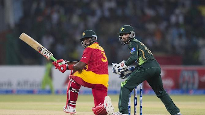 Zimbabwe's Hamilton Masakadza hits boundary as Pakistan's wicketkeeper Mohammad Rizwan looks on during a match at the Gaddafi Stadium in Lahore, Pakistan, Sunday, May 24, 2015. The Twenty20 matches on Friday and Sunday mark a return of international cricket to Pakistan for the first time since gunmen attacked buses carrying the Sri Lankan cricket team and match officials in this eastern city six years ago. Security has been beefed up for the matches. (AP Photo/B.K. Bangash)