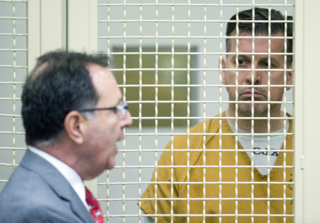Rainer Reinscheid, right, listens to his lawyer Ron Cordova during his arraignment at the Harbor Justice Center in Newport Beach, Calif. on Wednesday, Aug. 8, 2012. An amended complaint issued Wednesday charged Reinscheid with eight counts of arson and one count of attempted arson for a series of small fires at the park where his son hanged himself in March, the high school and the home of a school administrator who had disciplined his son. (AP Photo/The Orange County Register, Paul Bersebach, Pool)